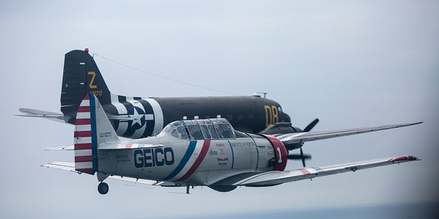 During a symbolic flight hosted by the American Airpower Museum on Long Island, the Skytypers flew by the Statue of Liberty alongside a Douglas C-47 -- a military transport aircraft used to deploy paratroopers during D-Day.