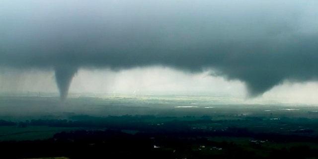 Two funnel clouds form near Crescent, Okla. Monday afternoon. (KWTV-KOTV via AP)