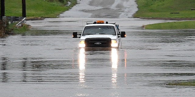 "A pickup truck drives on a flooded street in Enid, Okla., Monday, May 20, 2019. An intense storm system that weather forecasters labeled ""particularly dangerous"" swept through the Southern Plains Monday, spawning a few tornadoes that caused some damage and a deluge of rain but no reports of injuries."