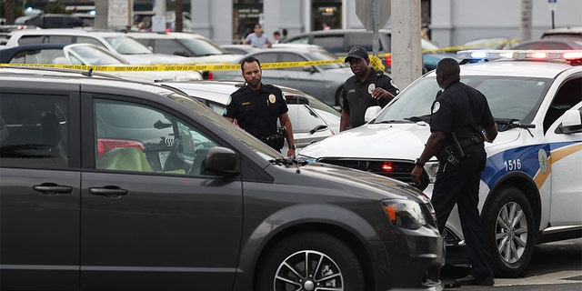 Sunny Isles Beach police officers examine the scene of a shooting near the Trump International Beach Resort Sunday afternoon. (Joe Raedle/Getty Images)