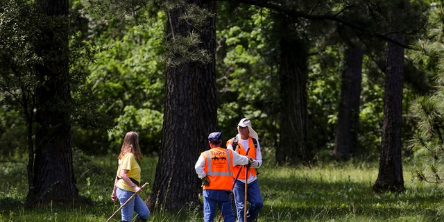 Members of Texas EquuSearch conduct a search for four-year-old Maleah Davis Monday in Humble, Texas.