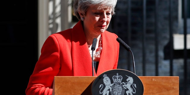 British Prime Minister Theresa May reacts as she turns away after making a speech in the street outside 10 Downing Street in London, England, Friday, May 24, 2019. Theresa May says she'll quit as UK Conservative leader on June 7, sparking contest for Britain's next prime minister.