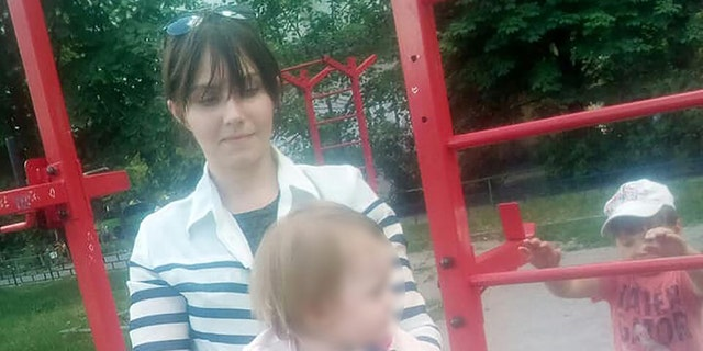 Viktoriya Devyatkina, 27, with her toddler daughter Alexandra, 24 months old.