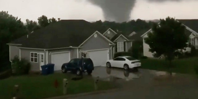 This still image taken from video provided by Chris Higgins shows a tornado in Carl Junction, Mo., on Wednesday, May 22, 2019. The tornado caused damage in the town about 4 miles north of the Joplin airport. (Chris Higgins via AP)