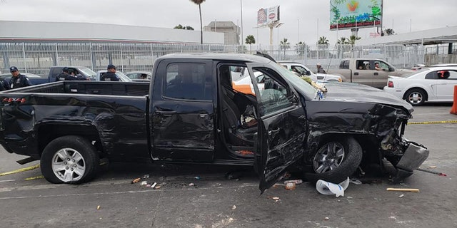 A damaged truck is seen after Mexican police said an American man tried to rush the U.S. border in Tijuana and crashed into 17 vehicles, vendor carts, and ran over 5 people on Monday.
