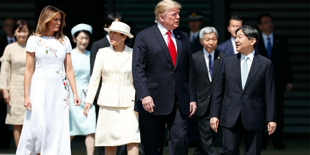 President Trump and first lady Melania Trump, escorted by Japan's Emperor Naruhito, front right, and Empress Masako, fourth left, during the welcome ceremony at the Imperial Palace in Tokyo.