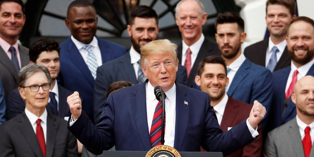 Boston Red Sox principal owner John Henry (in glasses) looks on as President Trump speaks during a ceremony honoring the club's 2018 World Series championship. (AP Photo/Pablo Martinez Monsivais)