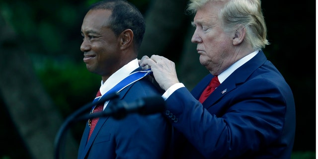 President Donald Trump awards golfer Tiger Woods the Presidential Medal of Freedom, in the Rose Garden of the White House, Monday, May 6, 2019, in Washington. (AP Photo/Evan Vucci)
