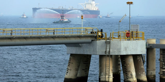 FILE - In this Sept. 21, 2016 file photo, an oil tanker approaches to the new Jetty during the launch of the new $650 million oil facility in Fujairah, United Arab Emirates. (AP Photo/Kamran Jebreili)