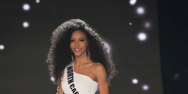Cheslie Kryst, Miss North Carolina USA 2019, competes on stage in her evening gown during the MISS USA® Preliminary Competition at Grand Sierra Resort and Casino's (GSR) Grand Theatre on Monday, April 29. — Patrick Prather