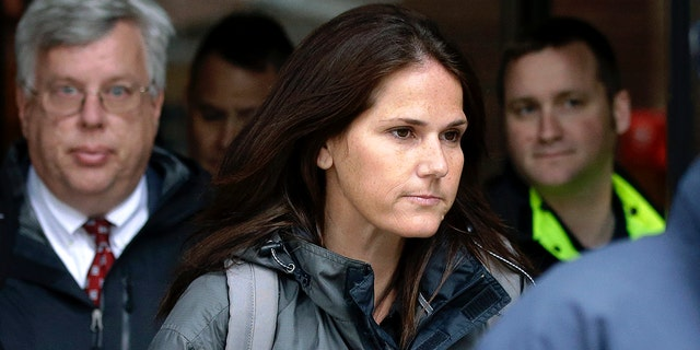 Former University of Southern California soccer manager Laura Janke departs sovereign court, Tuesday, May 14, 2019, in Boston, where she pleaded guilty to charges in a national college admissions temptation scandal. (AP Photo/Steven Senne)