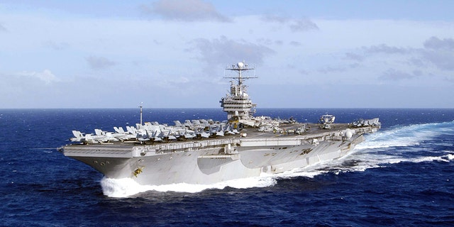 The USS Abraham Lincoln in the waters of Western Pacific Ocean in 2004. The ship is now heading to the Middle East.