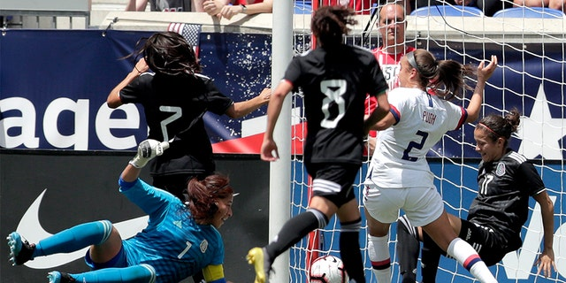 United States forward Mallory Pugh (2) scoring a goal as Mexico's Cecilia Santiago (1), Daniela Espinosa (7), Joana Robles (8) and Yamile Franco (17) tried to stop her. (AP Photo/Julio Cortez)