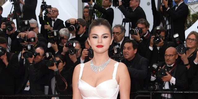 Actress Selena Gomez poses for photographers upon arrival at the opening ceremony and the premiere of the film 'The Dead Don't Die' at the 72nd international film festival, Cannes, southern France, Tuesday, May 14, 2019.