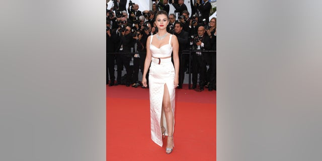 Actress Selena Gomez poses for photographers upon arrival at the opening ceremony and the premiere of the film 'The Dead Don't Die' at the 72nd international film festival, Cannes, southern France, Tuesday, May 14, 2019. (AP)