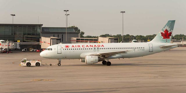 Five people aboard an Air Canada Express plane were injured on Friday when the aircraft was struck by a fuel track on the tarmac at Toronto Pearson International Airport.