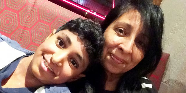 Karan, pictured with his mom, was given an expired EpiPen due to a spreadsheet error, the court heard Thursday.