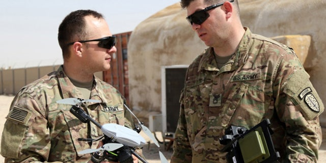 Soldiers conduct training with the Instanteye quadcopter. (Courtesy U.S. Army)