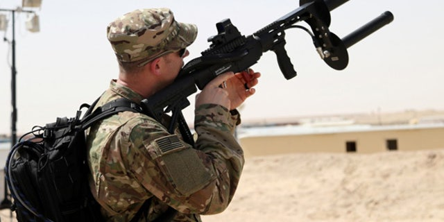 A soldier uses the Drone Defender to counter enemy drones. (Courtesy of U.S. Army)