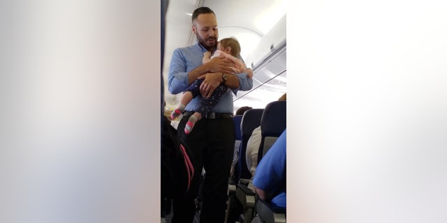 Southwest staffer Wesley Hunt, pictured, said that comforting baby Alayna was simply the right thing to do.
