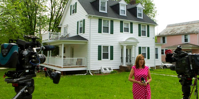 TV crews report form outside the house of Baltimore Mayor Catherine Pugh in Baltimore, MD., Thursday, April 25, 2019.