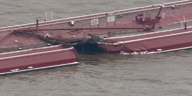 A tugboat carrying two barges collided with a 755-foot oil tanker in the Houston Ship Channel on Friday, causing one of the barges to sink and spilling chemicals used to make gasoline.
