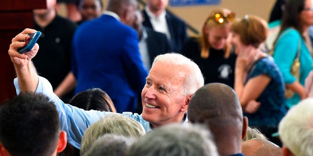 Former Vice President Joe Biden takes photos with supporters following the first rally of his 2020 campaign, Saturday, May 4, 2019 in Columbia, S.C. (AP Photo/Meg Kinnard)