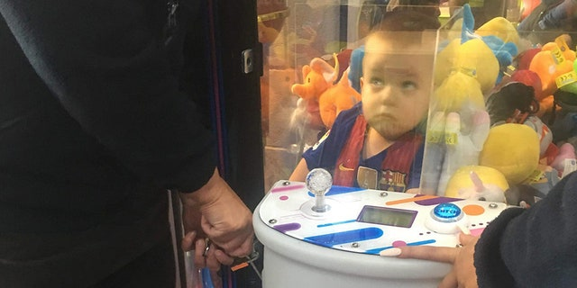 A mother-of-three was left in hysterics after anticipating her son Noah, pictured, had climbed into a fondle arcade appurtenance in hopes of nabbing a teddy bear.