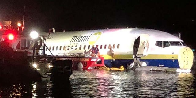 A Miami Air International jet is seen in the St. Johns River in Jacksonville, Fla., on Friday night after sliding off a runway. (Jacksonville Sheriff's Office)