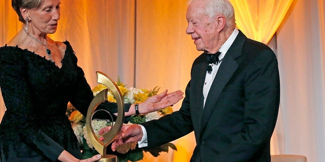 Former President Jimmy Carter accepts the O'Connor Justice Prize from the former U.S. ambassador to Finland, Barbara Barrett, in 2017. (AP Photo/Ross D. Franklin, File)