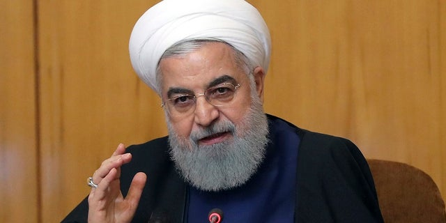 Iranian President Hassan Rouhani speaks in a cabinet meeting in Tehran, Iran, Wednesday, May 8, 2019. Rouhani said Wednesday that it will begin keeping its excess uranium and heavy water from its nuclear program, setting a 60-day deadline for new terms to its nuclear deal with world powers before it will resume higher uranium enrichment. (Iranian Presidency Office via AP)