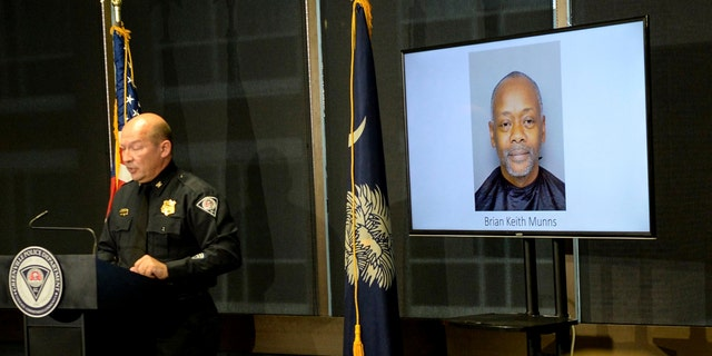 A Greenville police photo of arrested suspect Brian Keith Munns is displayed as police chief Ken Miller talks about an arrest in the 1988 cold case homicide of Alice Haynesworth Ryan.
