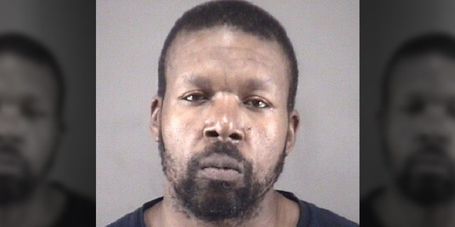 Tyrone Donte Gladden, 46, is accused of stabbing his two roommates, dismembering the bodies and disposing of them in a nearby wooded area.