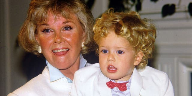 Doris Day poses with her grandson Ryan Melcher and then 4, the son of her only child Terry Melcher, at a press conference in the hotel she owns in Carmel, California on July 16, 1985. The day passed away Monday.