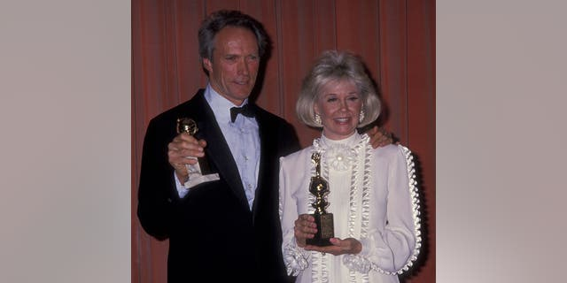 Actor Clint Eastwood and actress Doris Day attend 46th Annual Golden Globe Awards on January 28, 1989 at the Beverly Hilton Hotel in Beverly Hills, California.