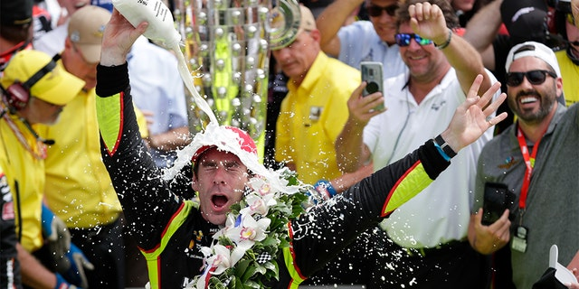 Simon Pagenaud, of France, celebrating after winning a Indianapolis 500 on Sunday. (AP Photo/Michael Conroy)