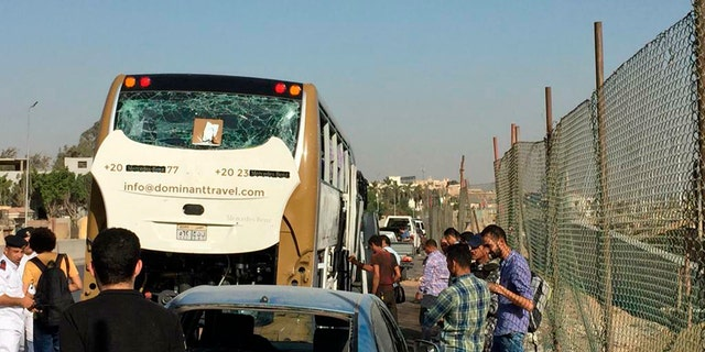 Egyptian officials said a roadside bomb hit a tourist bus near the famed Giza Pyramids on Sunday.