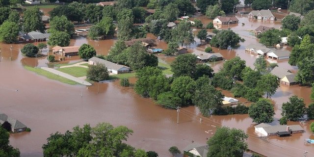 Homes flooded near the Arkansas River in Tulsa, Okla., last Friday.