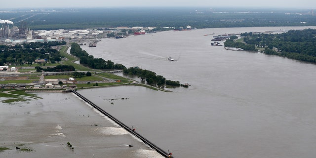 Torrential rains in Louisiana brought such a rapid rise on the river that the Army Corps of Engineers is opening the Bonnet Carre Spillway four days earlier than planned. Spokesman Ricky Boyett says the river rose six inches in 24 hours.