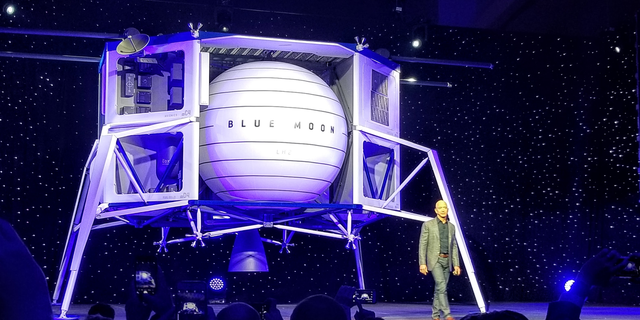 Blue Origin founder Jeff Bezos unveils a mockup of the Blue Moon lunar lander on May 9, 2019.