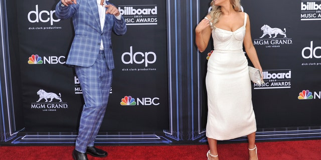 Rob Gronkowski, left, and Camille Kostek arrive at the Billboard Music Awards on Wednesday, May 1, 2019, at the MGM Grand Garden Arena in Las Vegas. (Photo by Richard Shotwell/Invision/AP)