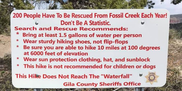 """""""Don't be a statistic,"""" a search and rescue sign reads ahead of the trail. Recommendations include bringing at least 1.5 gallons of water per person, wearing sturdy hiking shoes and ensuring that you are able to to hike 10 miles at 100 degrees at 6,000 feet of elevation before embarking on the excursion."""