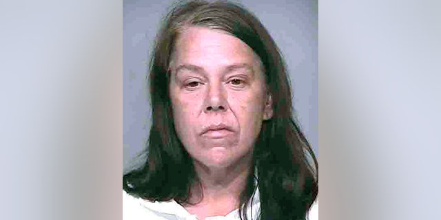 Brennan allegedly set a bottle of gin on her dead mother's stomach after the murder. (AP)