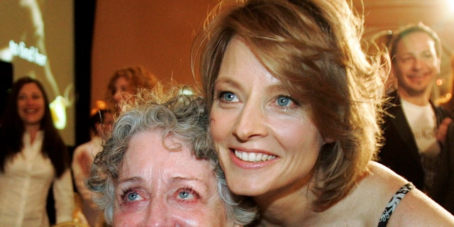 """FILE - This Dec. 4, 2007 file photo shows actress-director Jodie Foster, right, with her mother Evelyn Foster after she received the Sherry Lansing Leadership Award at during the 16th annual Women in Entertainment breakfast in Beverly Hills, Calif. Evelyn """"Brandy"""" Foster, who managed her daughter Jodie's career from her child-prodigy years through two Academy Awards, died peacefully at her Los Angeles home of complications from dementia, Monday, May 13, 2019."""