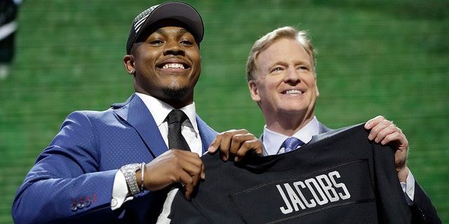 Alabama running back Josh Jacobs poses with NFL Commissioner Roger Goodell after the Oakland Raiders selected Jacobs in the first round at the NFL football draft, Thursday, April 25, 2019, in Nashville, Tenn.(AP Photo/Mark Humphrey)