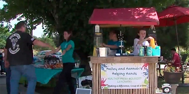 Two young sistersare turning lemons into lemonade through their efforts to pay off their local school district's $41,000 lunch debt, by running a charitable lemonade stand.