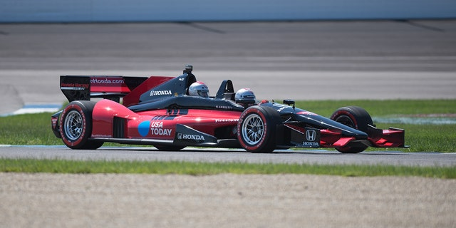 Andretti drives this custom two-seat Indycar at select events.