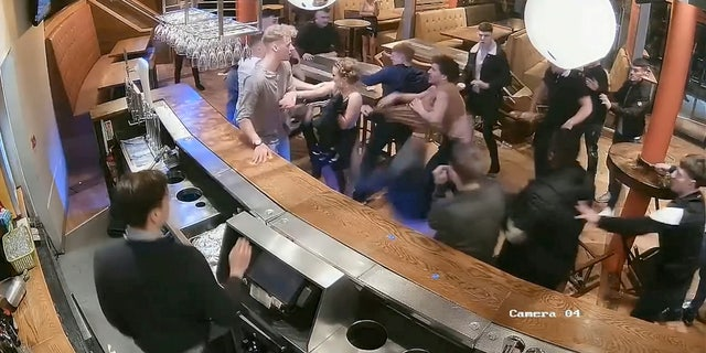The fight, which was captured on surveillance video, took place at the Arc Bar in Headingley, West Yorkshire, in February of 2018.