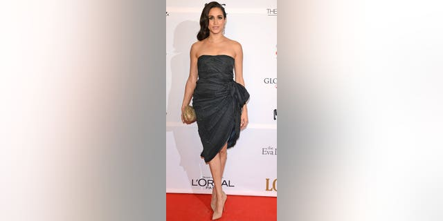 Meghan Markle attends the London Global Gift Gala at ME Hotel on November 19, 2013. She bonded with TV host Lizzie Cundy at the event, then allegedly ghosted her after she began dating with Prince Harry.