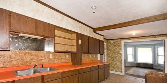 """The inside needs to be gutted…there's a cork backsplash, orange countertops in the kitchen, and nobody wants that today,"" the owner says."